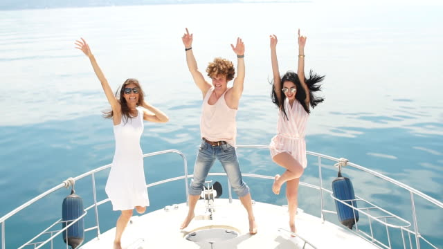 young happy caucasian people dancing in boat party - cruise video stock e b–roll