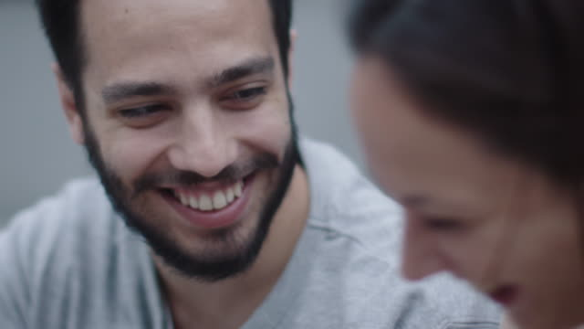 Young Happy Smiling Man and Woman are Communicating Outdoors. Close-up, Slow Motion Shot. video
