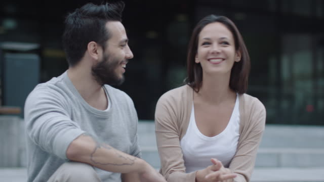 Young Happy Smiling Man and Woman are Communicating Outdoors. video