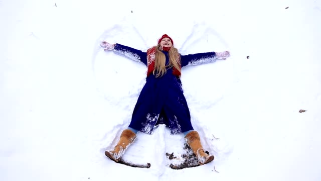 Young happy woman having fun on snow video