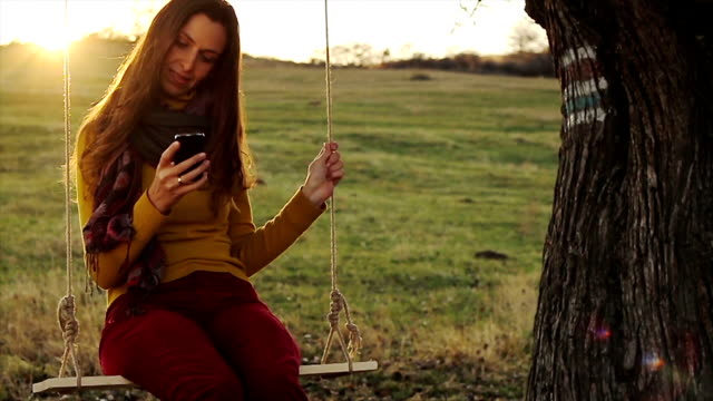 Young Happy Woman Texting in Nature Sunset Colors video