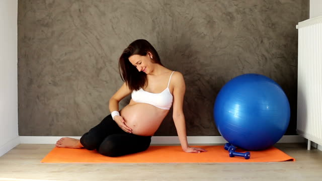 Young healthy pregnant woman video