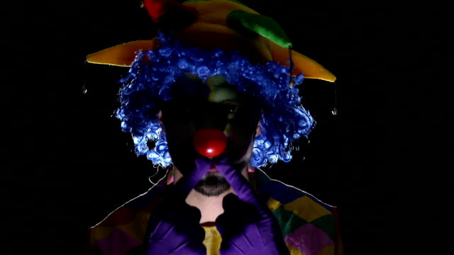 Young hilarious evil clown making scary faces video