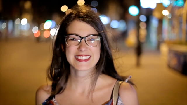Young hipster girl,portrait on the street at night,close up video
