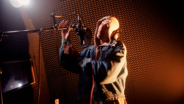 young hipster rapper recording songs at professional music recording studio - hip hop video stock e b–roll