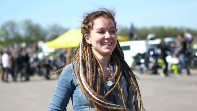 Young hipster woman with dreadlocks on street street video