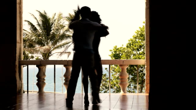 Young hispanic couple dancing latin american dance outdoors video