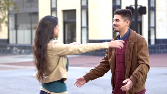 Young Hispanic couple meeting in the city video