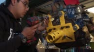 istock Young home mechanic using drill on car engine 1158753559