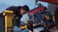istock Young home mechanic working on car engine 1158753685