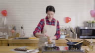 istock young housewife mixing melted liquid chocolate 1189030537