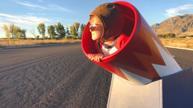 young human cannonball boy in cannon - rischio video stock e b–roll