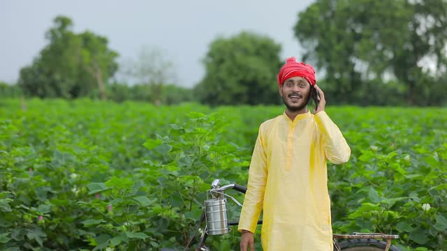 Young indian farmer or labor talking on mobile phone