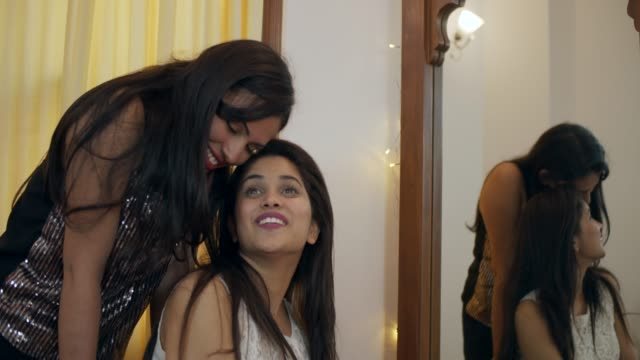 Young Indian female couple getting ready for a party