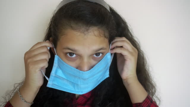 Young Indian girl wearing a medicine mask video