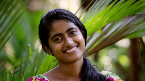 Young Indian - Sri Lankan woman smiling to the camera Young Indian - Sri Lankan woman smiling to the camera outdoors, close up portrait black hair stock videos & royalty-free footage