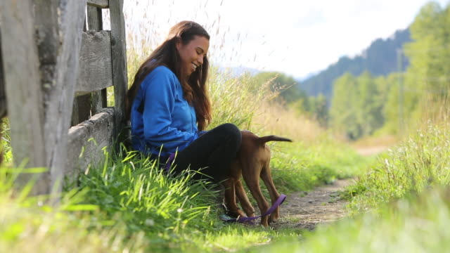 Young Indigenous Canadian woman playing with her dog video