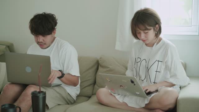 Young interracial couple shopping online