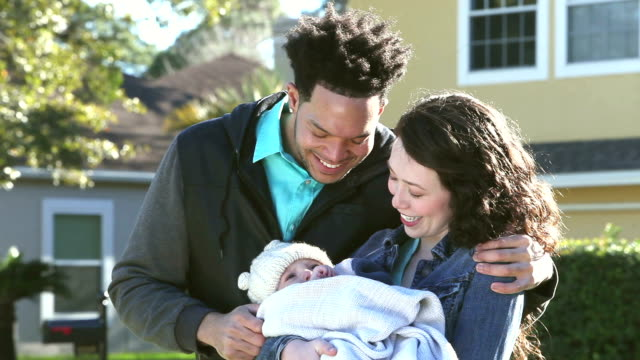 young interracial couple with baby boy - tre persone video stock e b–roll