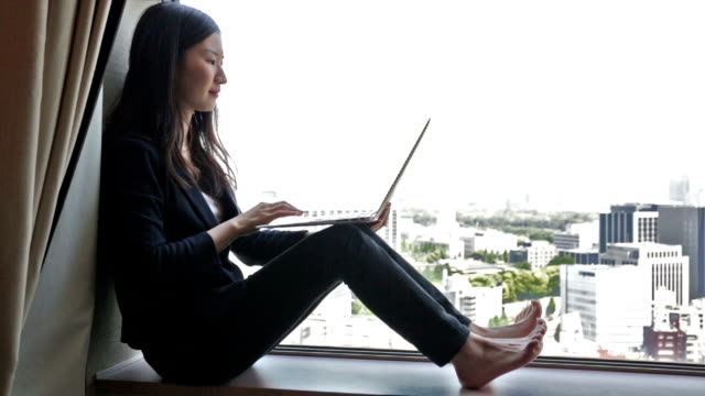 Young Japanese Businesswoman Working From Home video