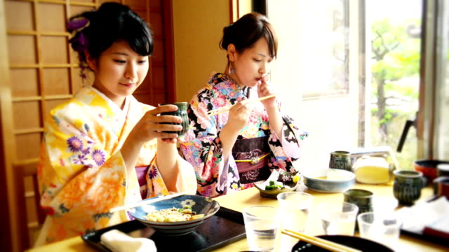Young Japanese woman eating out video