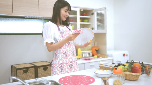 young japanese woman working at a kitchen - stay at home parent stock videos & royalty-free footage