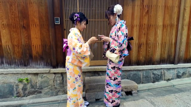 Young Japanese Women Meeting While Wearing Traditional Kimonos video