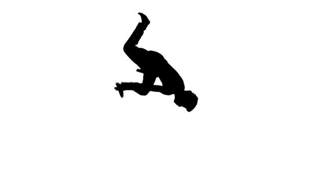 young karate or taekwondo It is doing a back flip, Silhouette video
