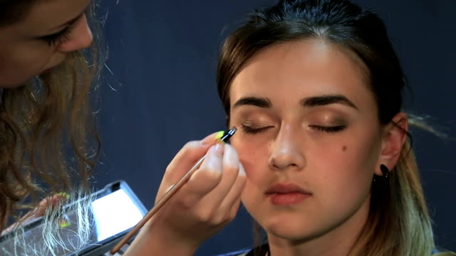 Young lady been applied with make up video