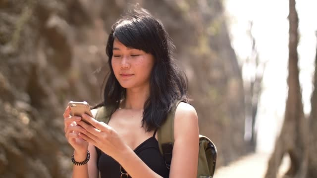 young lady chatting on mobile phone while traveling on vacation video