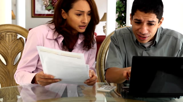 Young Latin Couple do Taxes and Pay Bills