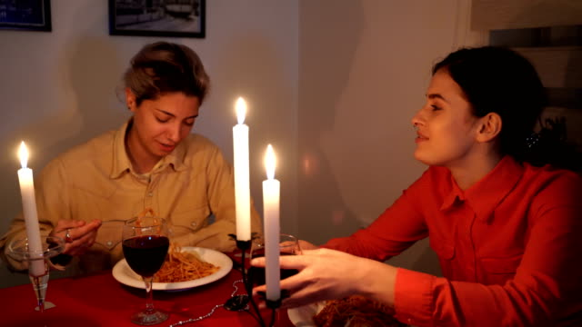 Young lesbian couple on romantic diner