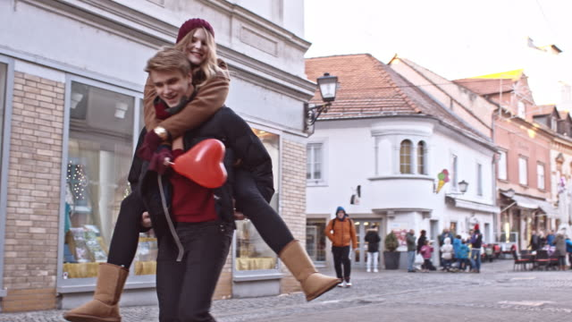 slo mo young loving couple in the city - valentines day stock videos and b-roll footage