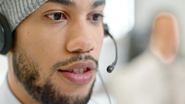 TU Young male call center operator talking to the customer video
