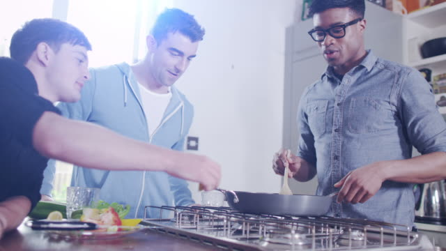 Young male friends in the kitchen video