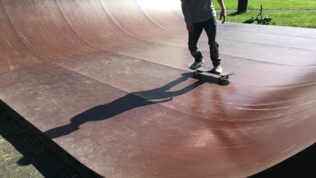 Young male skateboarder on a skateboarding ramp video