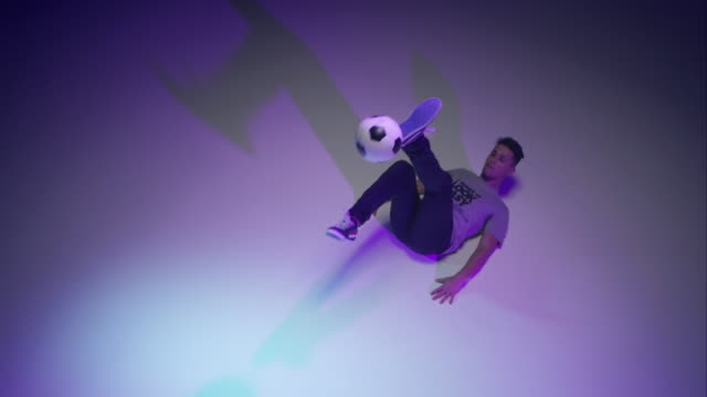 young male soccer freestyler juggling a ball on his brines video