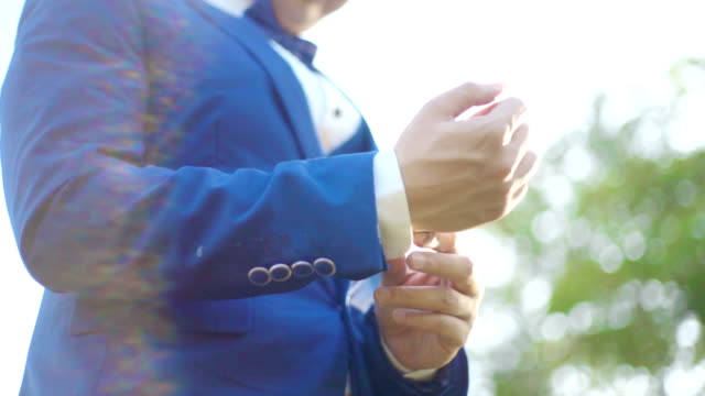 young man adjusting cufflinks his suit. - wedding fashion stock videos and b-roll footage