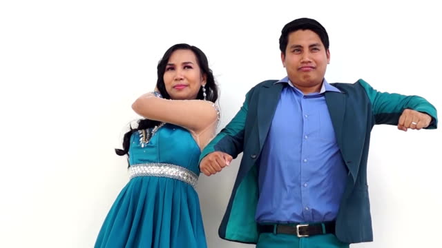 Young man and woman pose wacky on white background