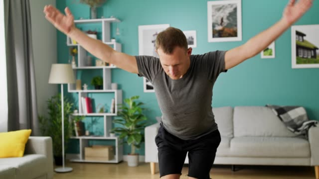 Young man are doing yoga at living room in the morning video