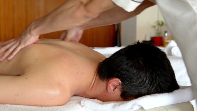 Young man at SPA treatment video