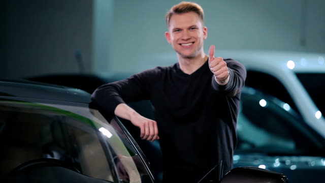 Young man buy a electric car video