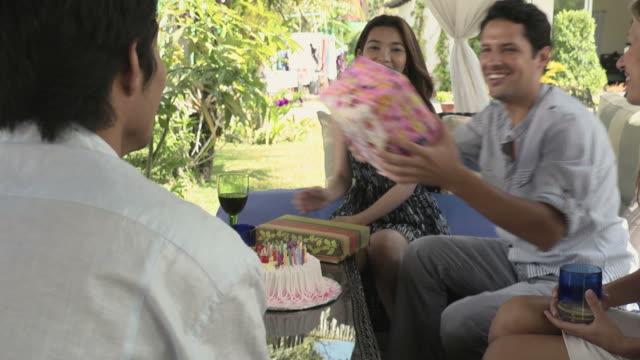 Young man celebrating his birthday during party at home video