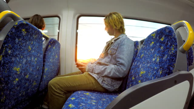 Young man commuting on the train video