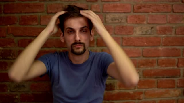 a young man completely shocked by the news - miroslav mitic stock videos and b-roll footage