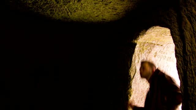 Young man dancing in the cave doorway video