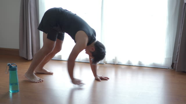 Young man doing Bodyweight Workout at home