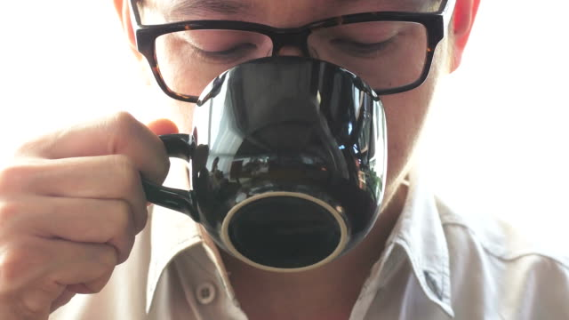 Young man drinking cofffee,Close-up video