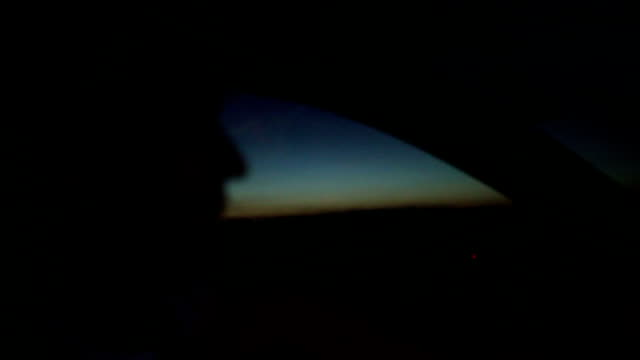 Young man driving a car in the night video