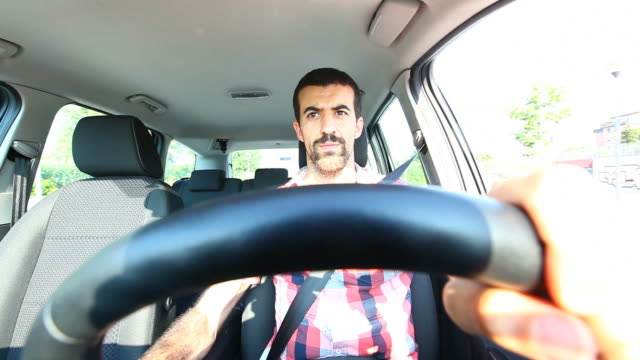 HD: Young Man Driving a Car video